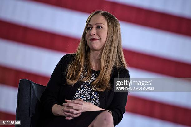 Chelsea Clinton listens as her mother Democratic presidential nominee Hillary Clinton speaks during a town hall meeting October 4 2016 in Haverford...