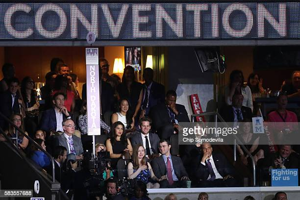Chelsea Clinton reacts to her father and former US President Bill Clinton as Marc Mezvinsky and with Sen Cory Booker look on during the the second...