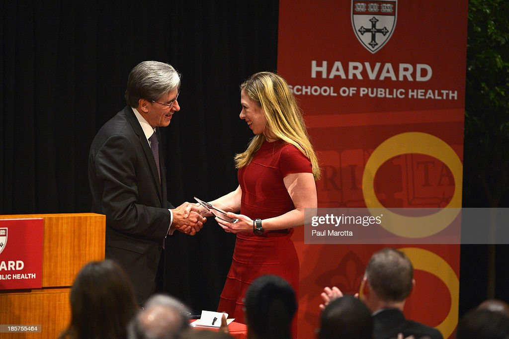 <a gi-track='captionPersonalityLinkClicked' href=/galleries/search?phrase=Chelsea+Clinton&family=editorial&specificpeople=119698 ng-click='$event.stopPropagation()'>Chelsea Clinton</a> receives the Next Generation Award from Harvard School of Public Health Dean of Faculty Julio Frenk on October 24, 2013 in Boston, Massachusetts.