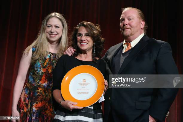 Chelsea Clinton Susi Cahn and chef Mario Batali pose onstage at the Food Bank For New York City's CanDo Awards celebrating 30 years of service to NYC...