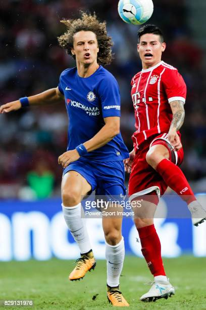 Chelsea Defender David Luiz trips up with Bayern Munich Midfielder James Rodríguez during the International Champions Cup match between Chelsea FC...