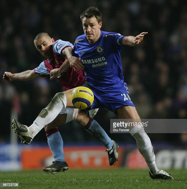 Chelsea defender John Terry R battles for posession with Villa striker Kevin Phillips during the Barclays Premiership game between Aston Villa ad...