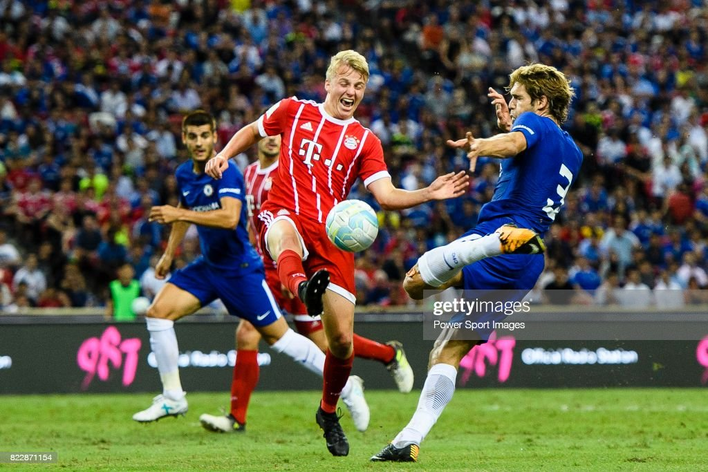 Chelsea Defender Marcos Alonso (R) fights for the ball with Bayern Munich Defender Felix Gotze (L) during the International Champions Cup match between Chelsea FC and FC Bayern Munich at National Stadium on July 25, 2017 in Singapore.