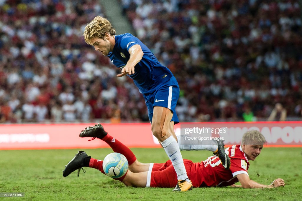 Chelsea Defender Marcos Alonso (L) fights for the ball with Bayern Munich Defender Felix Gotze (R) during the International Champions Cup match between Chelsea FC and FC Bayern Munich at National Stadium on July 25, 2017 in Singapore.