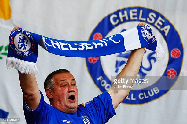 A chelsea fan cheer prior to the Barclays Premier League match between Chelsea and Southampton at Stamford Bridge on October 3 2015 in London United...