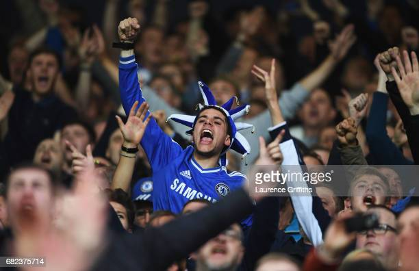 Chelsea fan cheers his team on during the Premier League match between West Bromwich Albion and Chelsea at The Hawthorns on May 12 2017 in West...