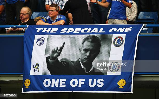 Chelsea fan displays a banner for manager Jose Mourinho prior to the Barclays Premier League match between Chelsea and Hull City at Stamford Bridge...
