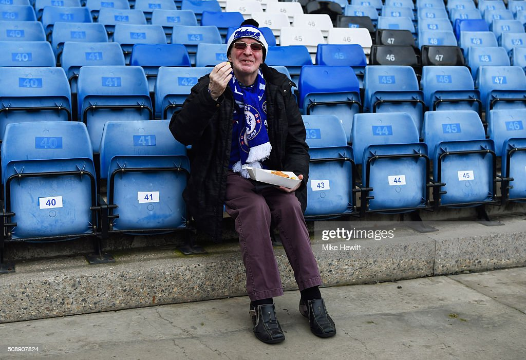 A Chelsea fan enjoys pre-match refreshments prior to the Barclays Premier League match between Chelsea and Manchester United at Stamford Bridge on February 7, 2016 in London, England.