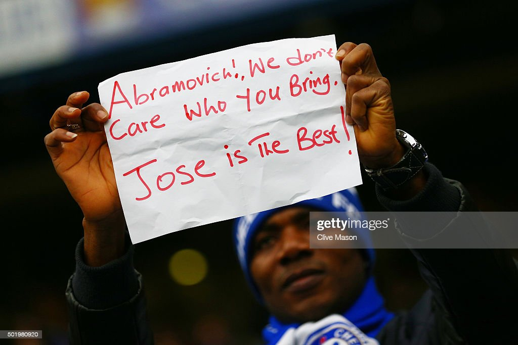 Chelsea fan holds a banner to support Jose Mourinho prior to the Barclays Premier League match between Chelsea and Sunderland at Stamford Bridge on...