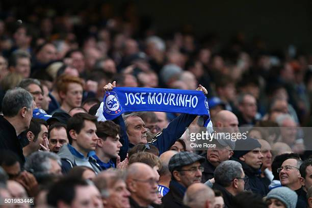 Chelsea fan holds the Jose Mourinho scarf prior to the Barclays Premier League match between Chelsea and Sunderland at Stamford Bridge on December 19...