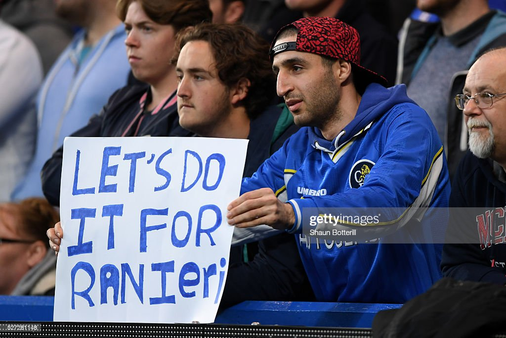 A Chelsea fan holds up a banner in support of Leicester City's title challenge during the Barclays Premier League match between Chelsea and Tottenham Hotspur at Stamford Bridge on May 02, 2016 in London, England.jd