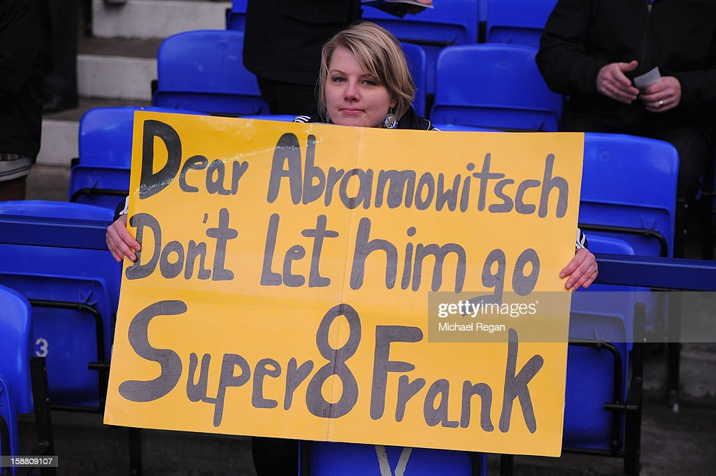 A Chelsea fan holds up a banner prior to the Barclays Premier League match between Everton and Chelsea at Goodison Park on December 30, 2012 in Liverpool, England.