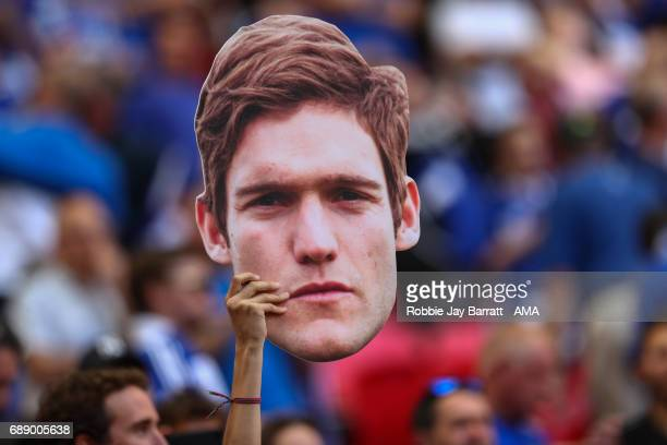 Chelsea fan holds up a giant face mask of Marcos Alonso of Chelsea prior to the Emirates FA Cup Final match between Arsenal and Chelsea at Wembley...