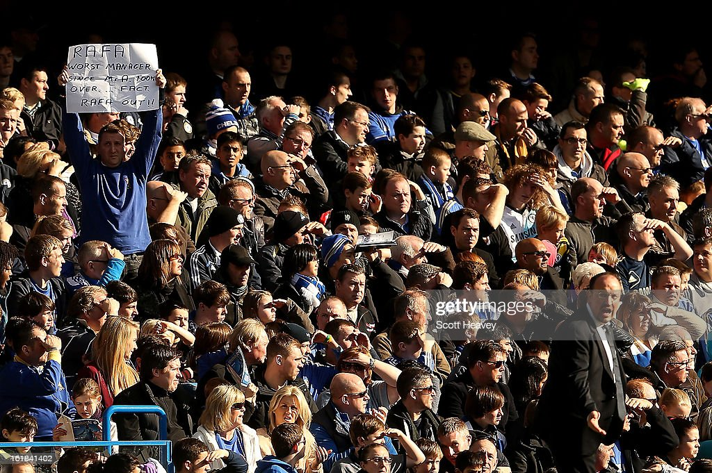 A Chelsea fan holds up a sign behind manager Rafael Benitez during the FA Cup Fourth Round Replay between Chelsea and Brentford at Stamford Bridge on February 17, 2013 in London, England.