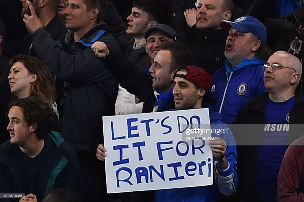 A Chelsea fan holds up a sign calling for his team to 'do it for Raneiri' during the English Premier League football match between Chelsea and Tottenham Hotspur at Stamford Bridge in London on May 2, 2016. / AFP / BEN STANSALL / RESTRICTED TO EDITORIAL USE. No use with unauthorized audio, video, data, fixture lists, club/league logos or 'live' services. Online in-match use limited to 75 images, no video emulation. No use in betting, games or single club/league/player publications. /