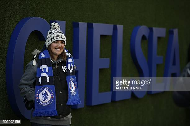 A Chelsea fan poses outside the ground before the English Premier League football match between Chelsea and Everton at Stamford Bridge in London on...