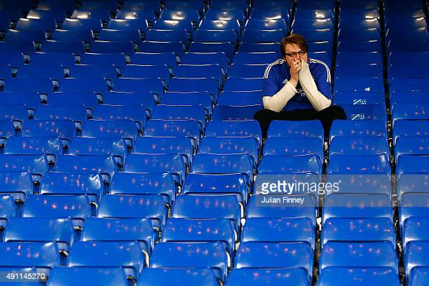Chelsea fan reacts after his team's 13 defeat in the Barclays Premier League match between Chelsea and Southampton at Stamford Bridge on October 3...