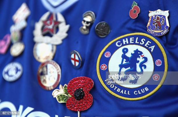 Chelsea fan shirt has a poppy badge in honour of Remembrance Day during the Premier League match between Chelsea and Everton at Stamford Bridge on...