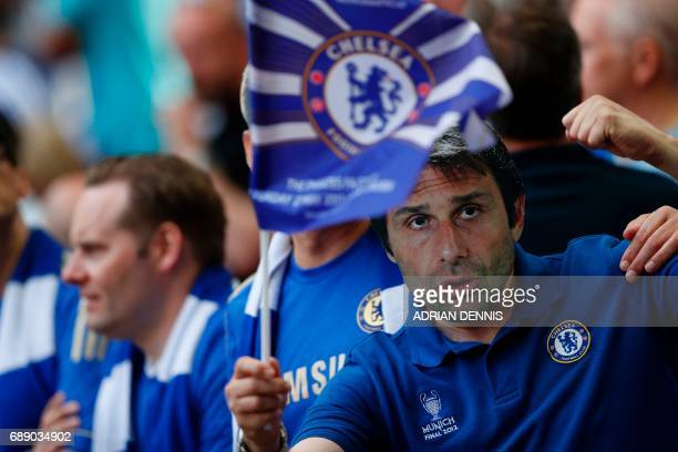 A Chelsea fan wearing a Antonio Conte mask waves a flag in the crown ahead of the English FA Cup final football match between Arsenal and Chelsea at...