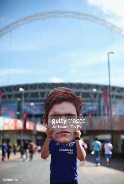 Chelsea fan with a Marcos Alonso of Chelsea head mask is seen outside the stadium prior to the Emirates FA Cup Final between Arsenal and Chelsea at...