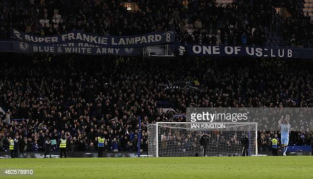 Chelsea fans applaud Manchester City's English midfielder Frank Lampard after the final whistle the English Premier League football match between...