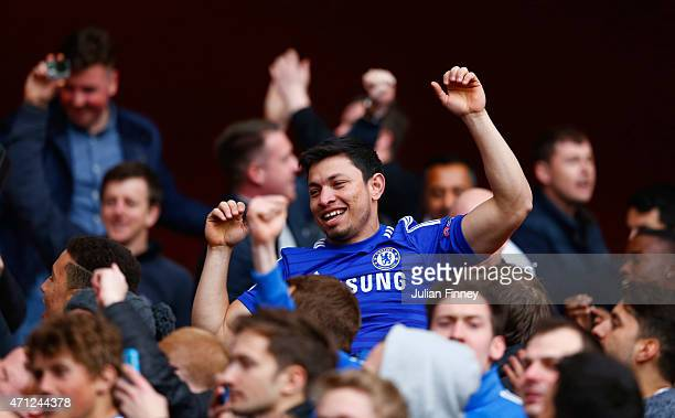 Chelsea fans celebrate after the Barclays Premier League match between Arsenal and Chelsea at Emirates Stadium on April 26 2015 in London England