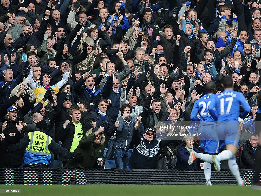 Chelsea fans celebrate Demba Ba's winning goal during the FA Cup Sixth Round Replay match between Chelsea and Manchester United at Stamford Bridge on April 1, 2013 in London, England.