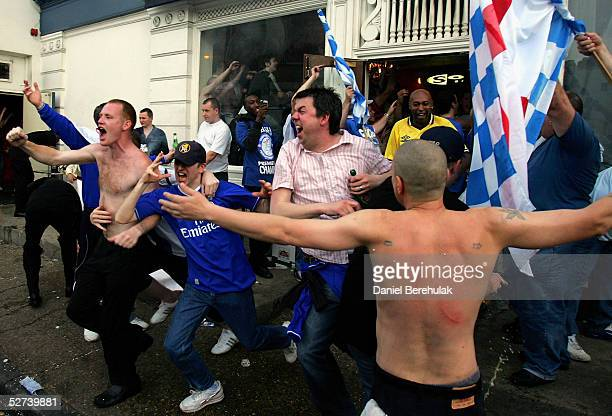 Chelsea fans celebrate their teams victory over Bolton outside the Stamford Bridge Stadium securing them the 2004/2005 Premiership title on April 30...