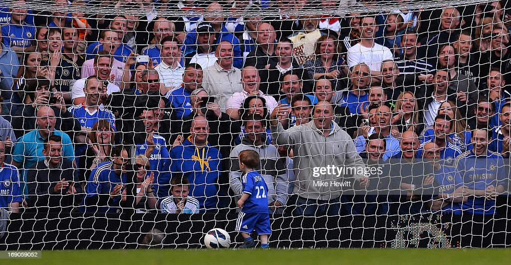 Chelsea fans cheer as Josh Turnball, son of Ross Turnball scores a goal during the Barclays Premier League match between Chelsea and Everton at Stamford Bridge on May 19, 2013 in London, England.