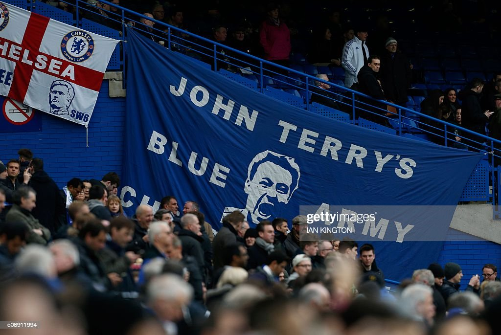 Chelsea fans display a giant banner reading 'John Terry's Blue Army' ahead of the English Premier League football match between Chelsea and Manchester United at Stamford Bridge in London on February 7, 2016. / AFP / Ian Kington / RESTRICTED TO EDITORIAL USE. No use with unauthorized audio, video, data, fixture lists, club/league logos or 'live' services. Online in-match use limited to 75 images, no video emulation. No use in betting, games or single club/league/player publications. /