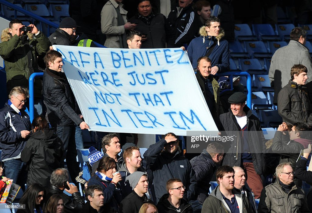 Chelsea fans hold a banner to show their discontent with Interim manager Raphael Benitez during the English Premier League football match between Chelsea and West Brom at Stamford Bridge in London on March 2, 2013. USE. No use with unauthorized audio, video, data, fixture lists, club/league logos or 'live' services. Online in-match use limited to 45 images, no video emulation. No use in betting, games or single club/league/player publications.
