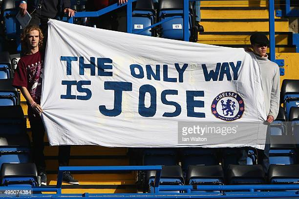 Chelsea fans hold a banner to show their faith to Jose Mourinho prior to the Barclays Premier League match between Chelsea and Liverpool at Stamford...