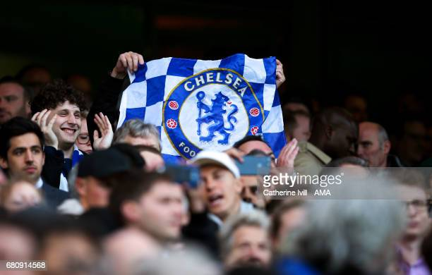 Chelsea fans hold up a flag during the Premier League match between Chelsea and Middlesbrough at Stamford Bridge on May 8 2017 in London England