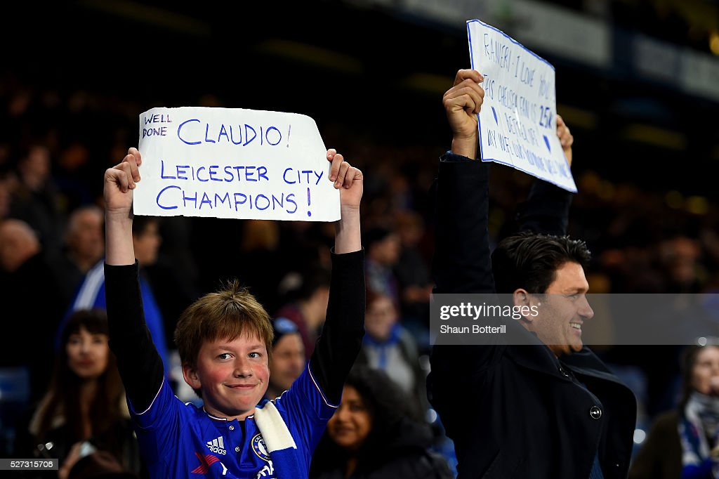 Chelsea fans hold up banners celebrating Leicester City being crowned champions following the 2-2 draw during the Barclays Premier League match between Chelsea and Tottenham Hotspur at Stamford Bridge on May 02, 2016 in London, England.jd