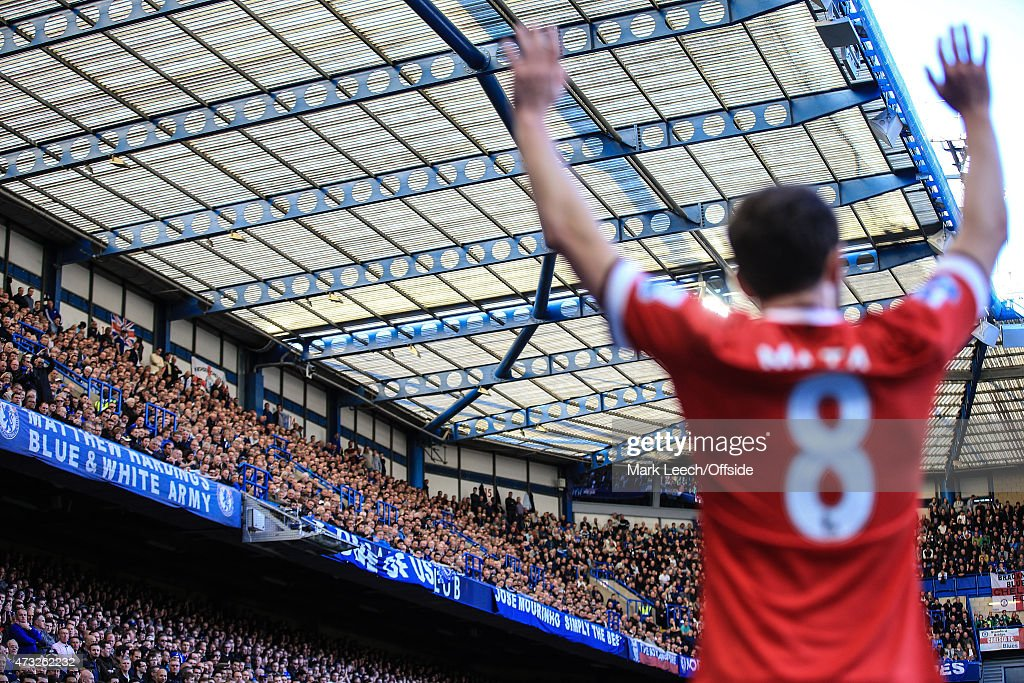 Chelsea fans look on as Juan Mata of Manchester United prepares to take a corner during the Barclays Premier League match between Chelsea and...