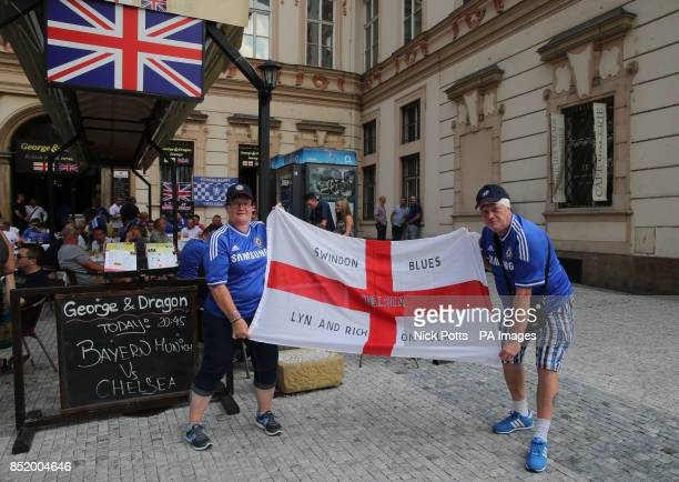 Chelsea fans Lyn and Rich from Swindon outside the George and Dragon pub in Prague's Old Town Square Czech Republic
