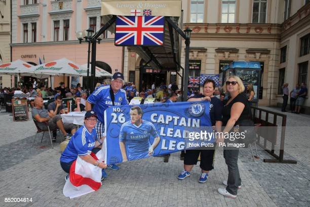 Chelsea fans Lyn Rich and friends from Swindon outside the George and Dragon pub in Prague's Old Town Square Czech Republic