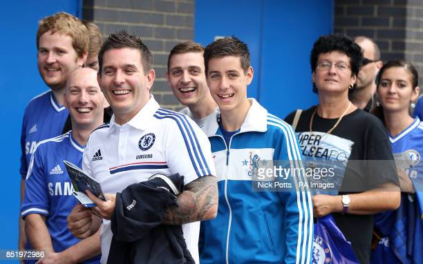 Chelsea fans queue to use the automatic ticket scanning and access system at Stamford Bridge