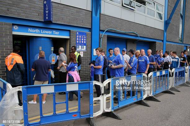 Chelsea fans queue to use the new automatic ticket scanning and access system