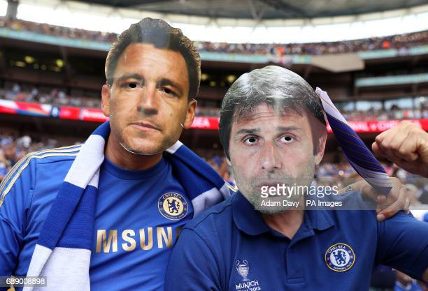 Chelsea fans show their support by wearing face masks of John Terry and Manager Antonio Conte during the Emirates FA Cup Final at Wembley Stadium...