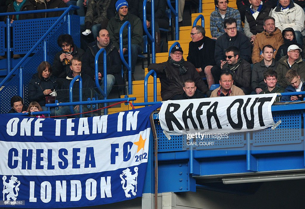 Chelsea fans sit behind a banner showing discontent with Interim manager Raphael Benitez during the English Premier League football match between Chelsea and West Brom at Stamford Bridge in London on March 2, 2013. USE. No use with unauthorized audio, video, data, fixture lists, club/league logos or 'live' services. Online in-match use limited to 45 images, no video emulation. No use in betting, games or single club/league/player publications.