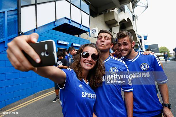 Chelsea fans take photographs after the Barclays Premier League match between Chelsea and Swansea City at Stamford Bridge on August 8 2015 in London...