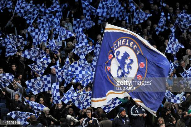 Chelsea fans wave flags ahead of the UEFA Champions League semifinal first leg football match between Chelsea and Barcelona at Stamford Bridge in...