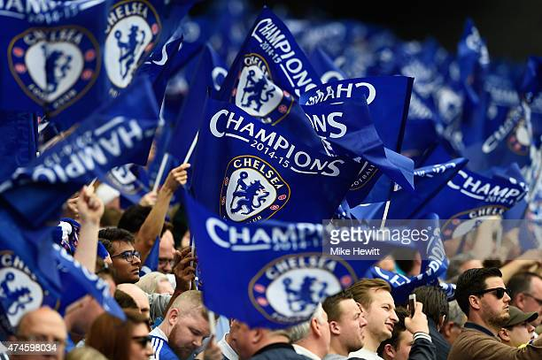 Chelsea fans wave flags prior to the Barclays Premier League match between Chelsea and Sunderland at Stamford Bridge on May 24 2015 in London England