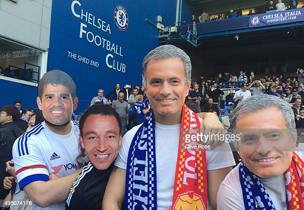 Chelsea fans wearing Jose Mourinho John Terry and Diego Costa masks are seen on the stand prior to the Barclays Premier League match between Chelsea...