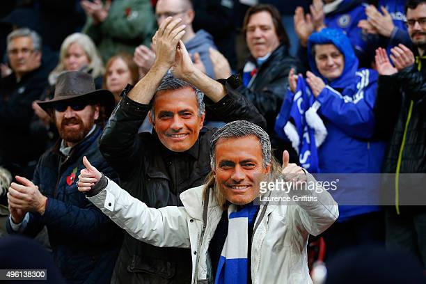 Chelsea fans wearing Jose Mourinho masks cheer prior to the Barclays Premier League match between Stoke City and Chelsea at Britannia Stadium on...