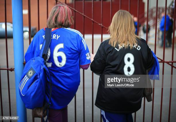 Chelsea fans wearing replica John Terry and Frank Lampard shirts wait behind a gate before the Barclays Premier League match between Aston Villa and...