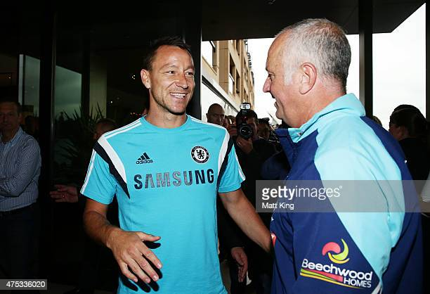 Chelsea FC captain John Terry speaks to Sydney FC head coach Graham Arnold after a press conference at the Park Hyatt Hotel on May 31 2015 in Sydney...