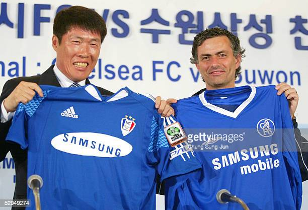 Chelsea FC coach Jose Mourinho and Suwon Samsung Bluewings coach Cha BumKun exchange their uniforms during a press conference at the Shilla hotel on...