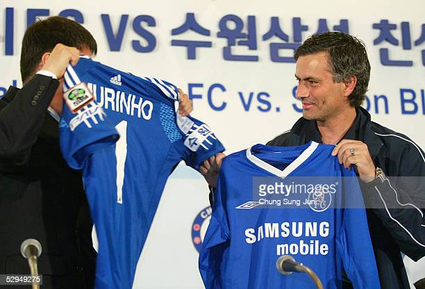 Chelsea FC coach Jose Mourinho and Suwon Samsung Bluewings coach Cha BumKun exchange shirts during a press conference at the Shilla hotel on May 19...